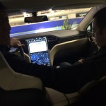 Inside shot of Dan Nainan driving his Tesla