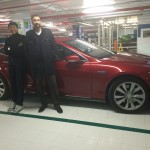 Shahryar and Dan Nainan in front of his Tesla in Arlington